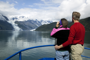 couple looking at columbia glacier prince william sound alaska from a boat